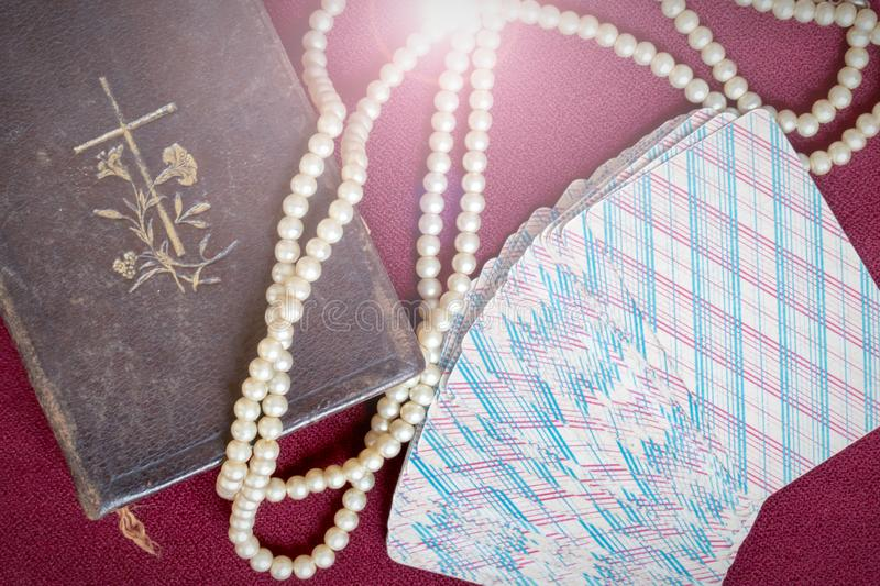 Old holy bible and cards on wooden table. Misticism and fortune telling, future prediction concept.  royalty free stock photo