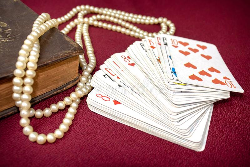 Old holy bible and cards on wooden table. Misticism and fortune telling, future prediction concept.  stock photography
