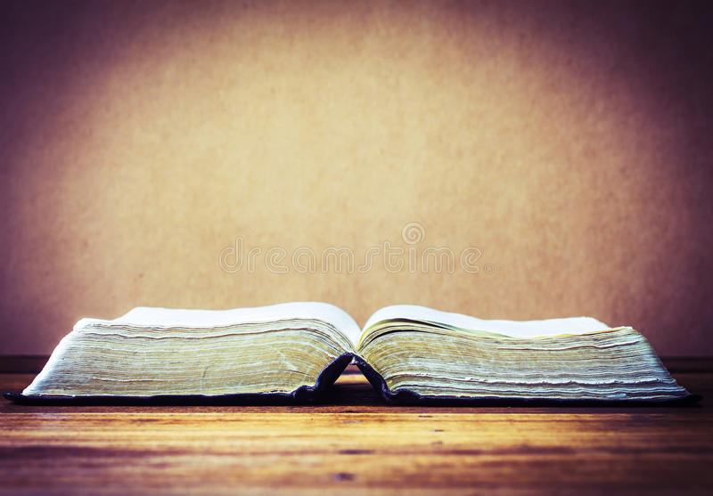 The old holy bible on wooden background stock images