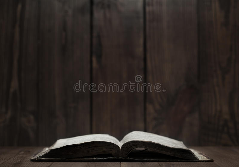Old Holy Bible on wooden background stock photo