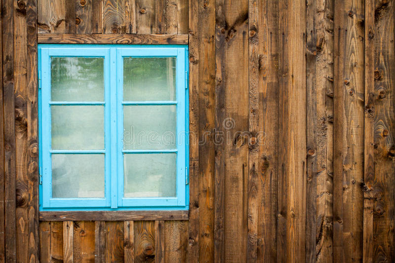 Old home with blue window stock images