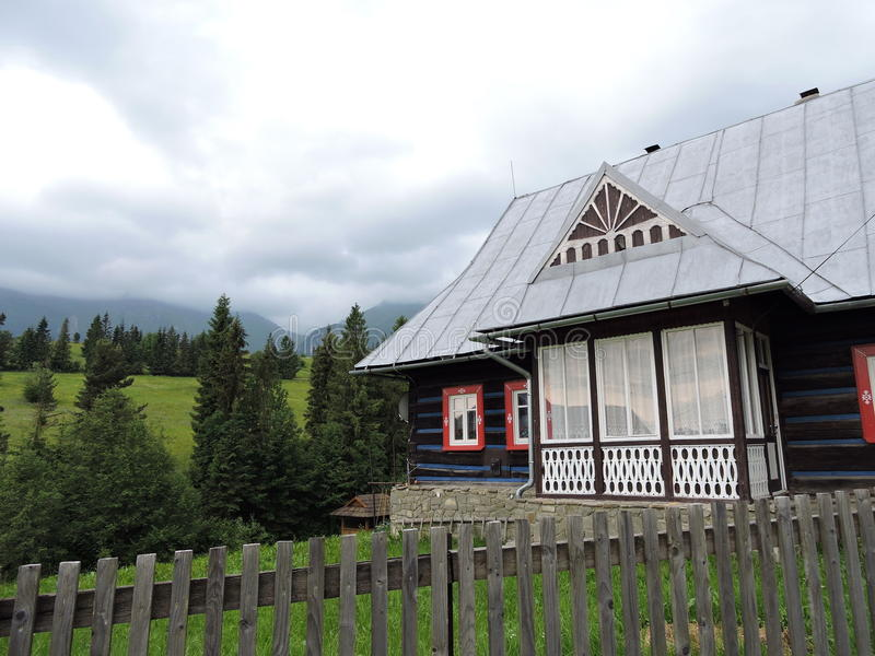 Old home near mountains. Old wooden home near Tatra mountains in Slovakia royalty free stock photography