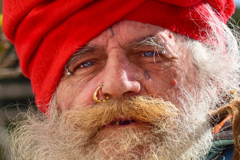 Old homeless guru roaming around. The old town of Taranto hoping to find something to eat and drink stock images