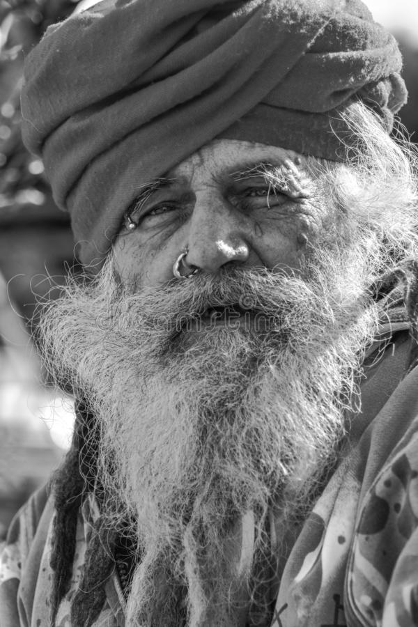 Old homeless guru roaming around. The old town of Taranto hoping to find something to eat and drink stock photo