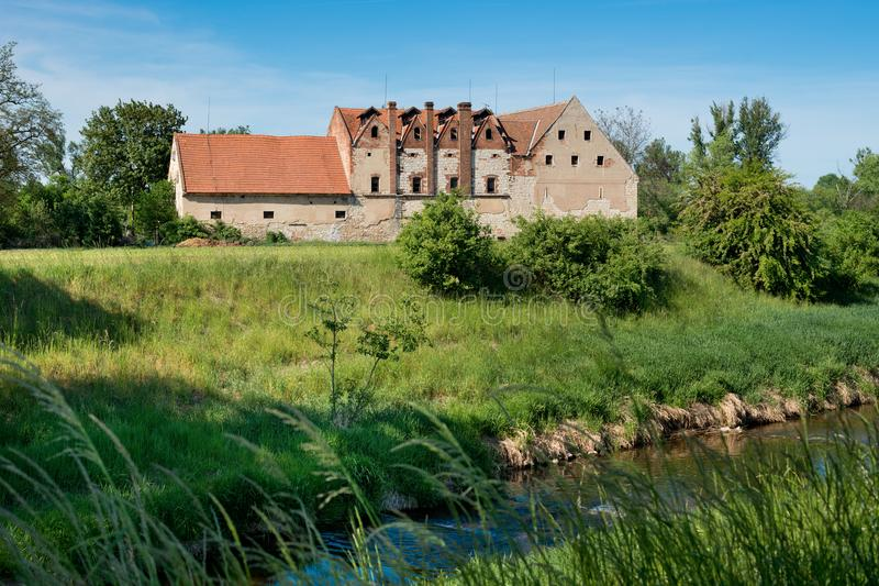 Old hop drying house in the Zatec hop area. Czech Republic stock photo
