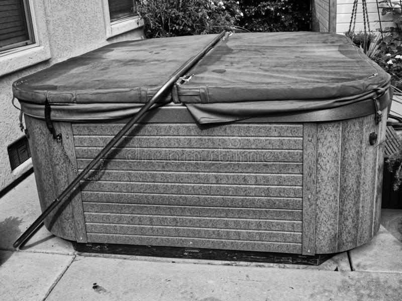 Old Hot Tub Has Seen Better Days. Worn out old hot tub ready to be hauled away and replaced by a newer model royalty free stock photos