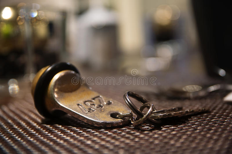 Old hotel room key from brass with the number 237, blurred background with copy space royalty free stock images