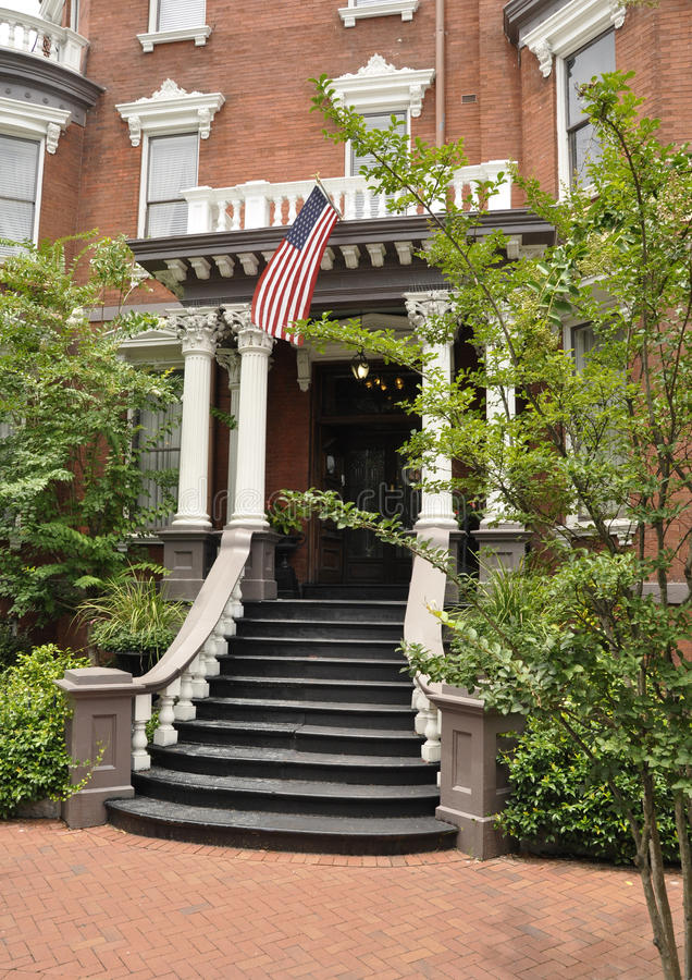 Old house with American flag royalty free stock images