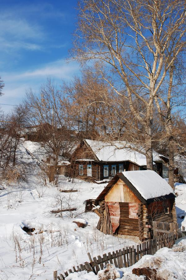 Old house and bathhouse in winter. Stairs on background stock image