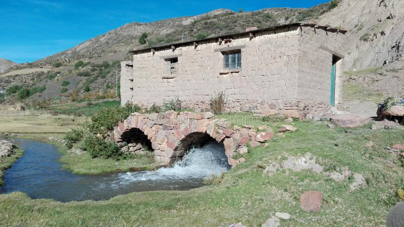 Old house built of mud. Old mud house, built on top of a bridge, this is located in Potosi, Bolivia stock photo