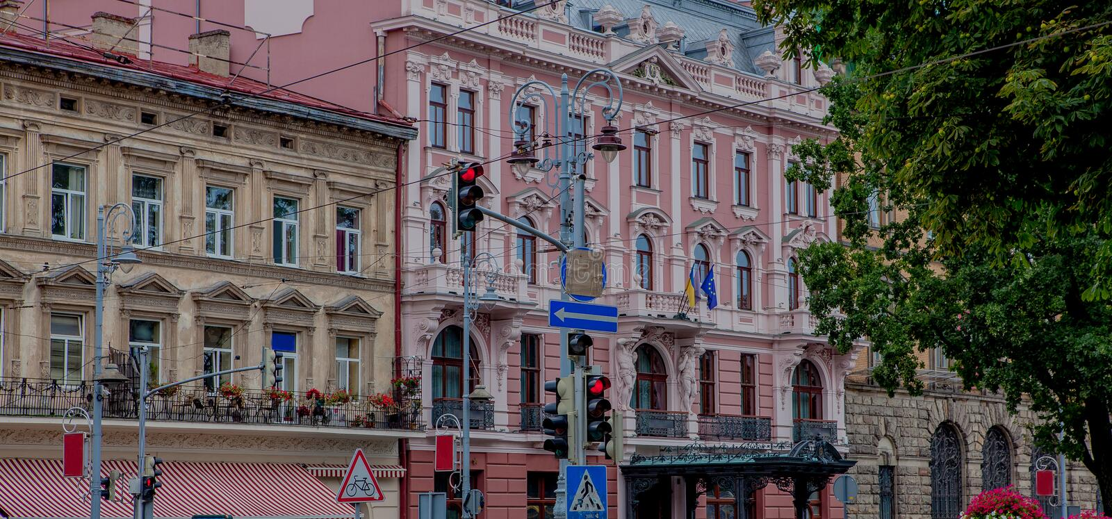 Old house in city. View on old street city in Ukraine. Road signs on the street.  royalty free stock photo