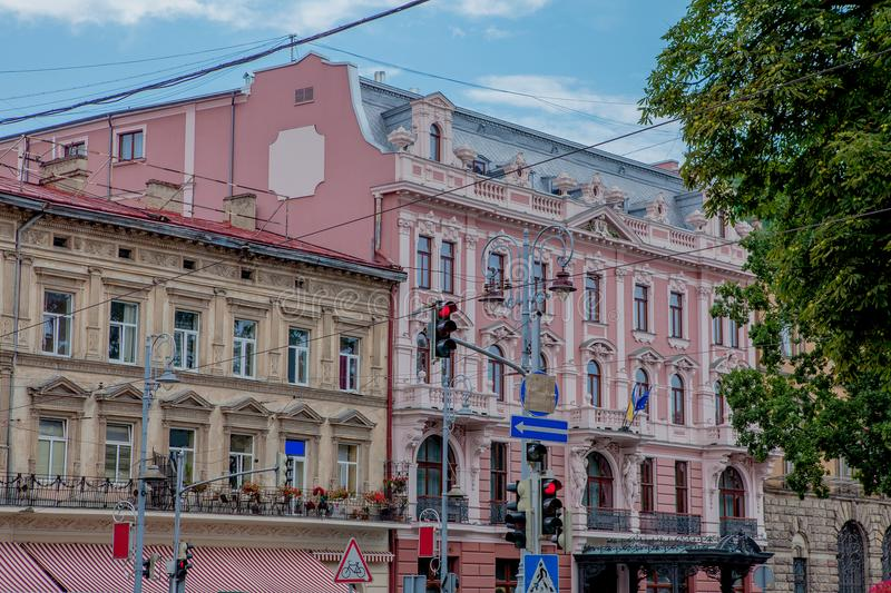 Old house in city. View on old street city in Ukraine. Road signs on the street.  royalty free stock images
