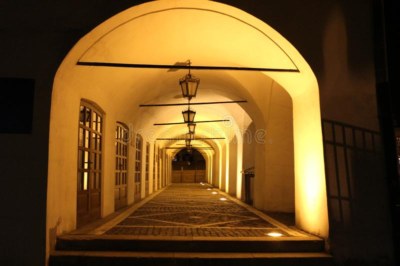 Old house corridor at night. With windows and lanterns in an old European town stock photos