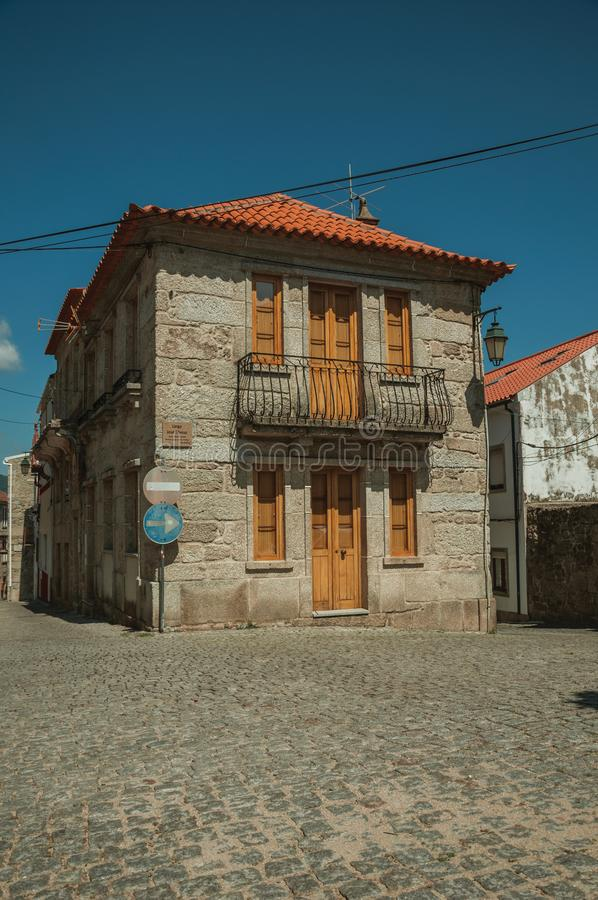 Old house on deserted alley and road signpost royalty free stock photography