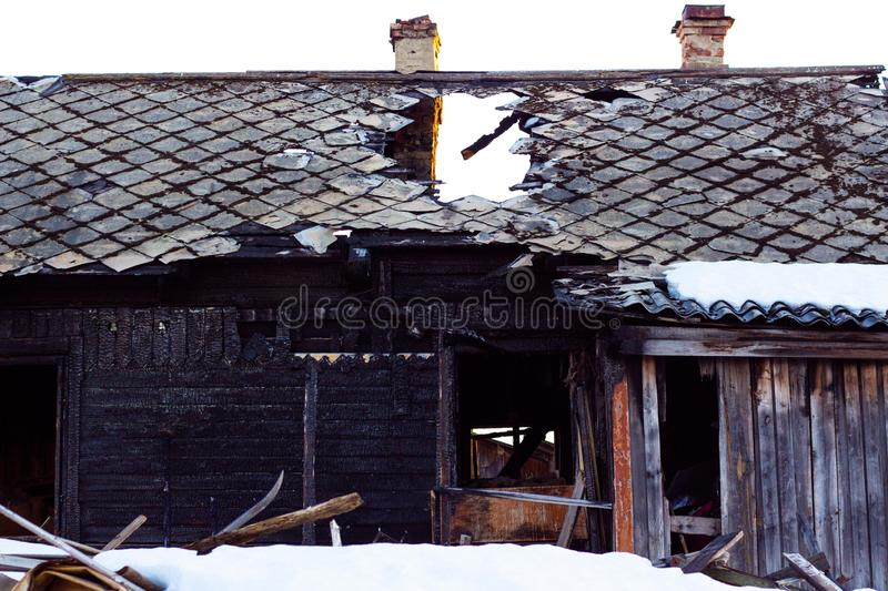 An old house that is destroyed by fire from a natural disaster or the negligence of people. Traces of fire are visible on the house stock image