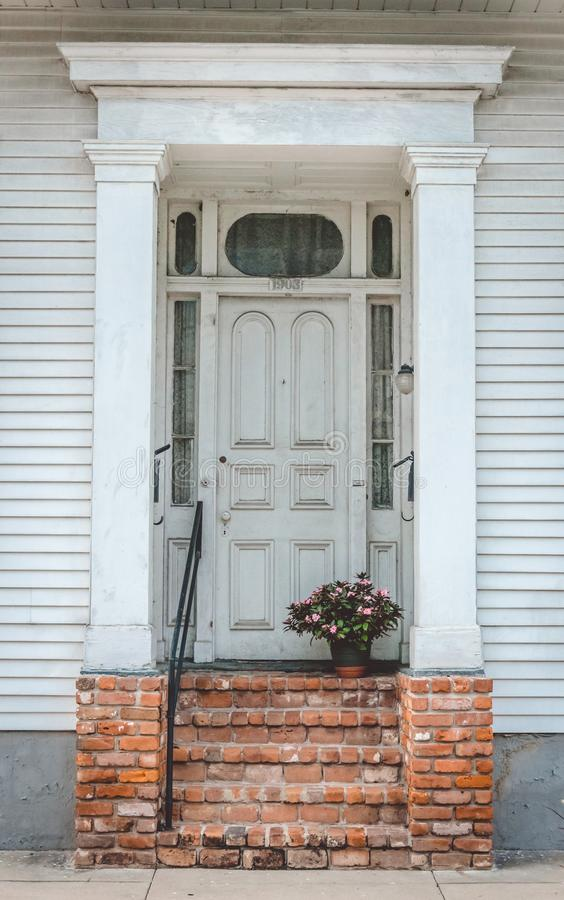 Old house in the French Quarter, New Orleans. Ancient wooden door royalty free stock photos