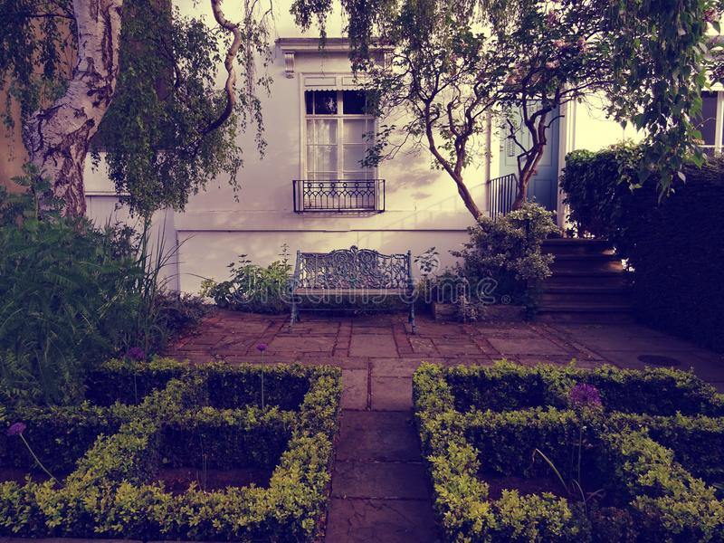 Old house and garden royalty free stock photography
