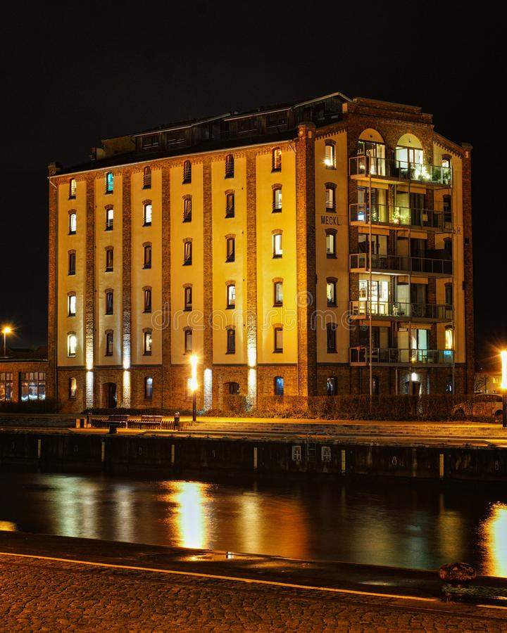 Old house in the harbor of Wismar at night royalty free stock image