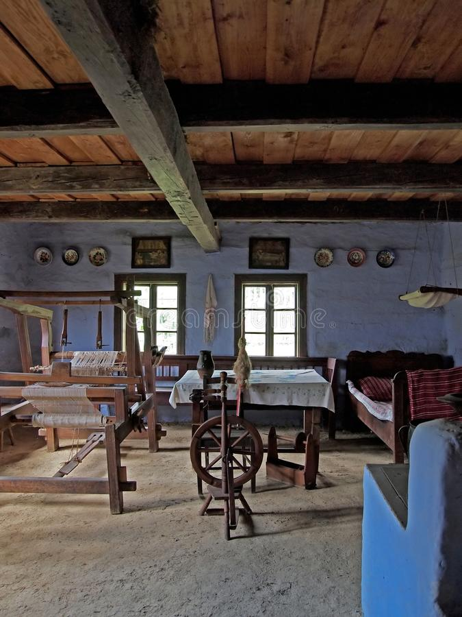 Old house interior. With old equipment like spinning wheel stock photo