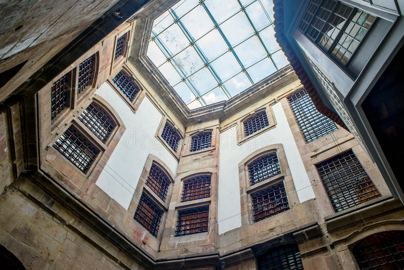 Old house interior gallery with glass roof window, old prison or castle stock photography