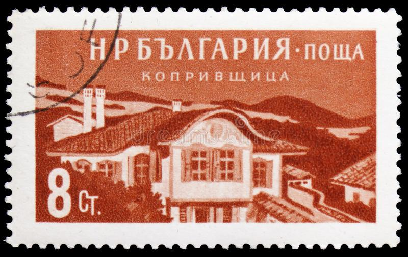 Old house in Koprivshtita, Bulgarian Recreation Facilities and Places serie, circa 1958. MOSCOW, RUSSIA - MARCH 23, 2019: Postage stamp printed in Bulgaria shows royalty free stock photography
