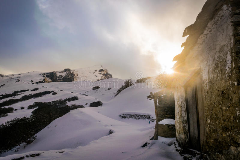 Old house in the mountain covered with snow. stock image