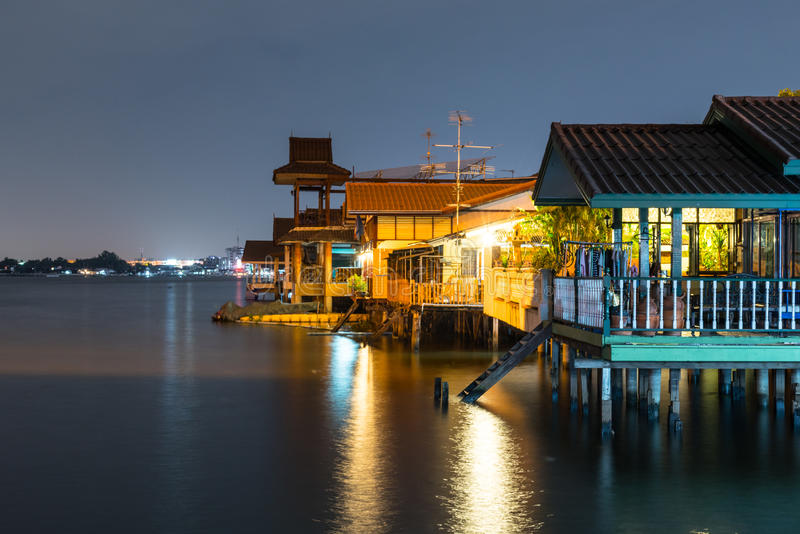 Old house near river/canal in Thailand. Waterfront lifestyle. Cu royalty free stock photography