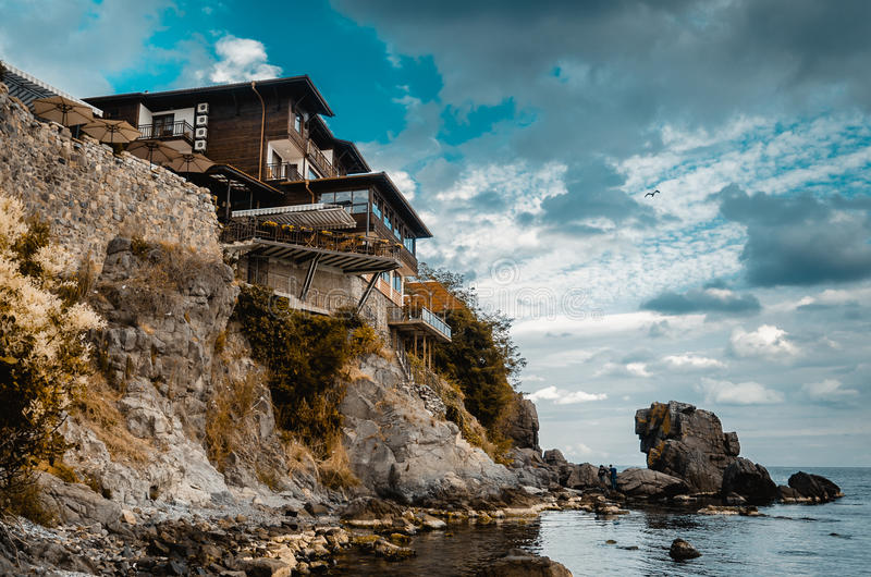 Old house on a rock cliff stock images