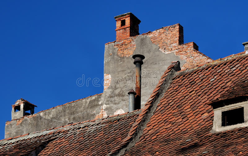 Old house roof in Brasov, Romania. Old house roof architecture in Brasov, Romania royalty free stock images