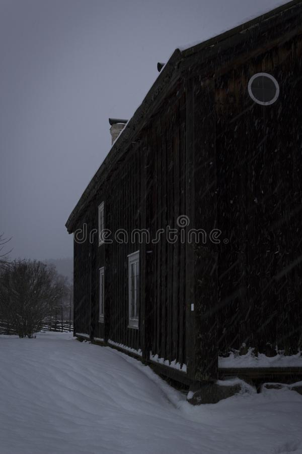 Old house in rural sweden, in harsh weather conditions. royalty free stock images