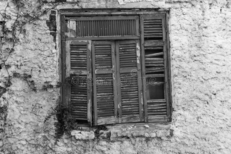 Old shutters. Old house`s shutters, black and white retro image of a ruined house royalty free stock images