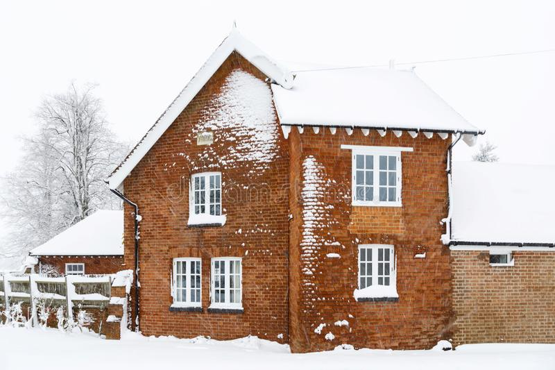 Old house in snow stock images