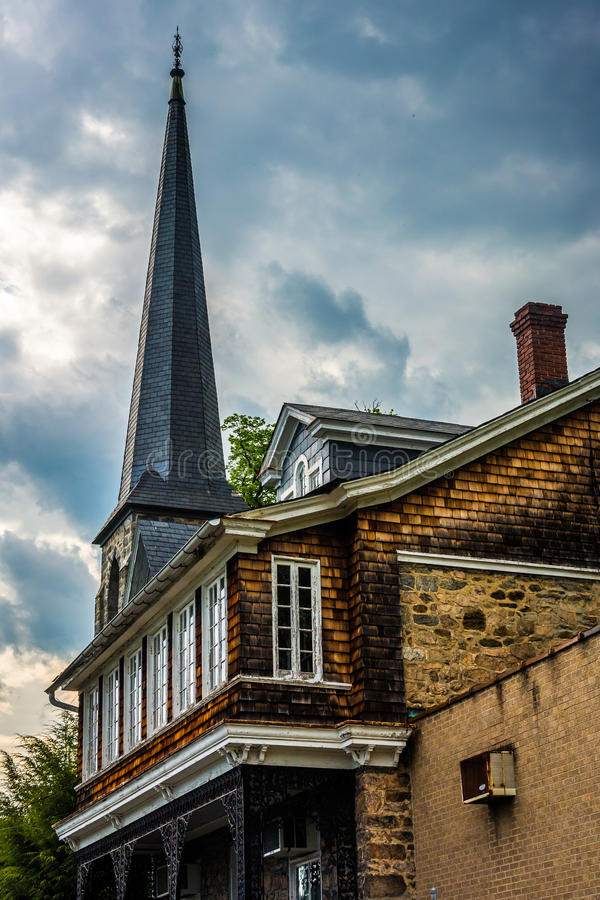 An old house and steeple of a chuch in Ellicott City, Maryland. An old house and steeple of a chuch in Ellicott City, Maryland stock images