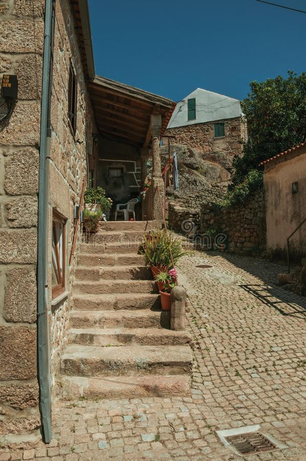 Old house with stone staircase and flower pots royalty free stock photo