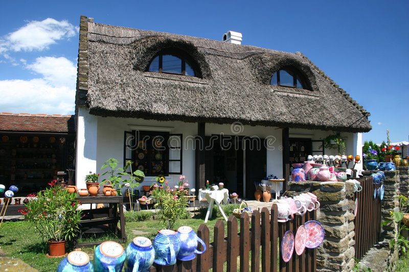Old house with thatched roof royalty free stock image