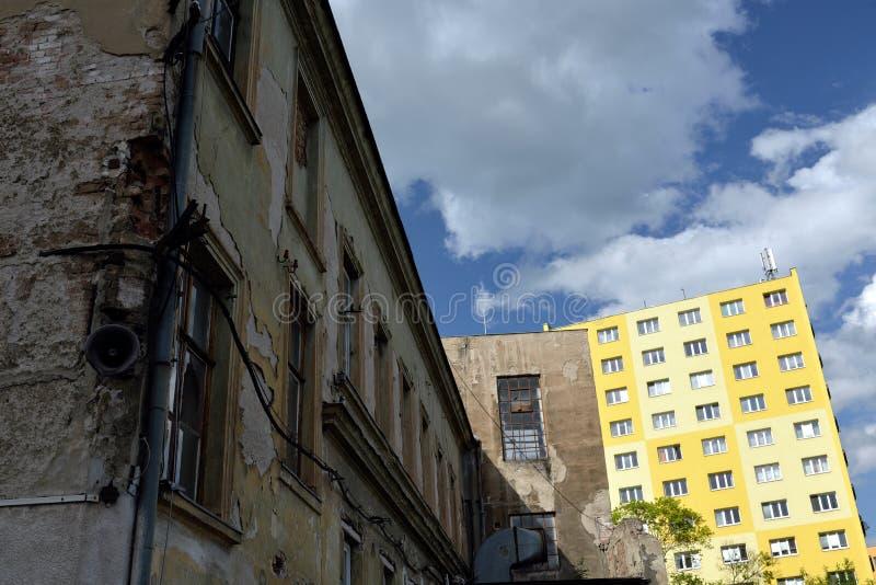 Old house versus rebuild block of flats stock photos