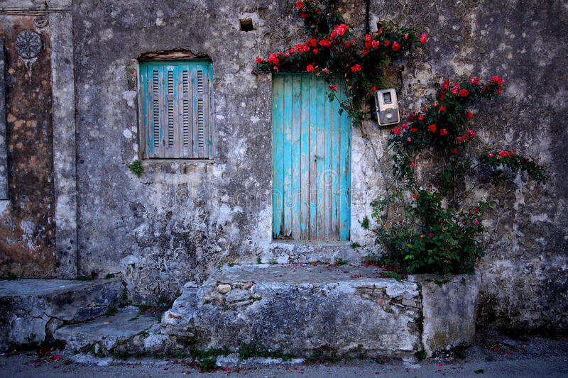 Old house wall and window with flowers stock photo