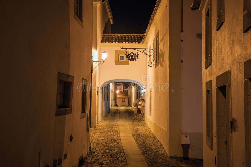 Old houses on alley with passageway under arch at night in Marvao stock photos