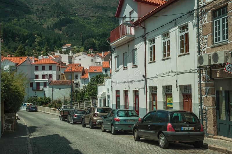 Old houses and a deserted alley with parked cars royalty free stock photos