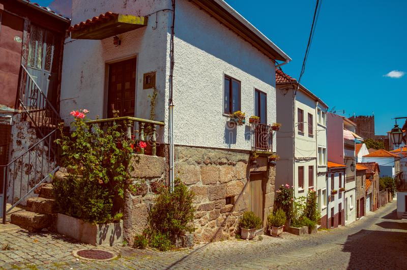 Old houses with flowering pots and deserted alley stock image