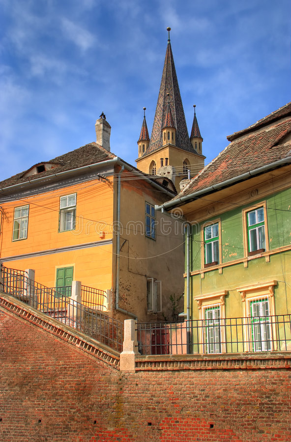 Download Old Houses In Front Of A Church Stock Image - Image: 4713167