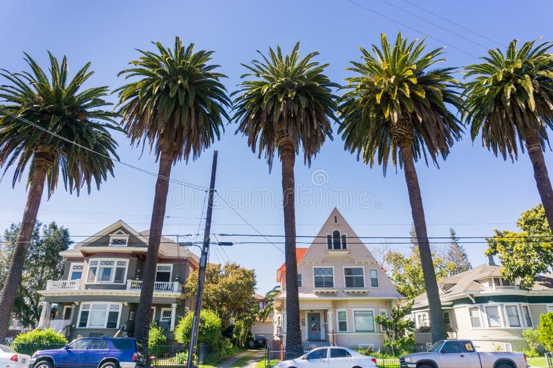Old houses and palm trees on a street in downtown San Jose, California royalty free stock image
