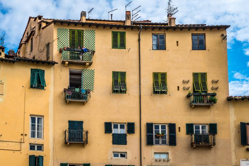 Old houses in Piazza dell`Anfiteatro, in Lucca. stock images
