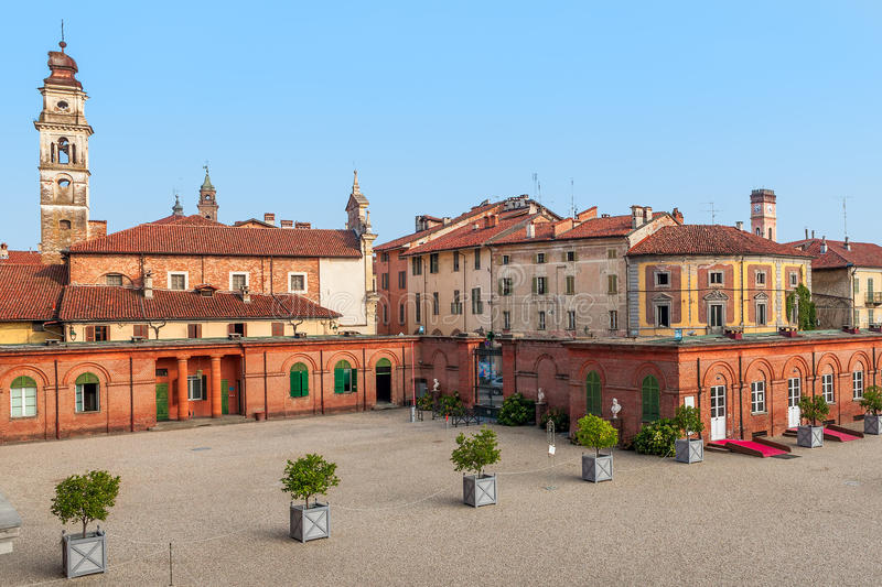 Old houses of racconigi, Italy. Bell tower among old houses in small town of racconigi in Piedmont, Italy stock image