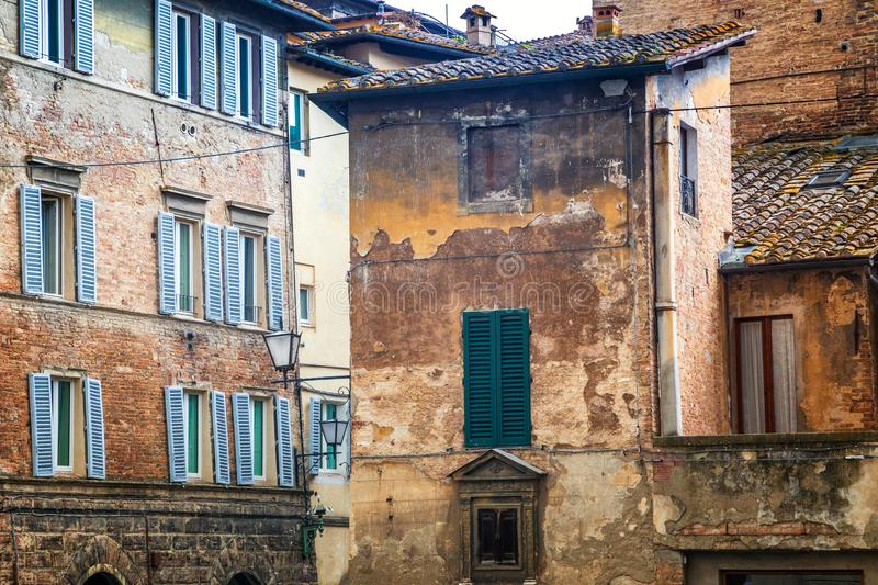 Old houses of Siena town, an ancient city in the Tuscany region royalty free stock photography