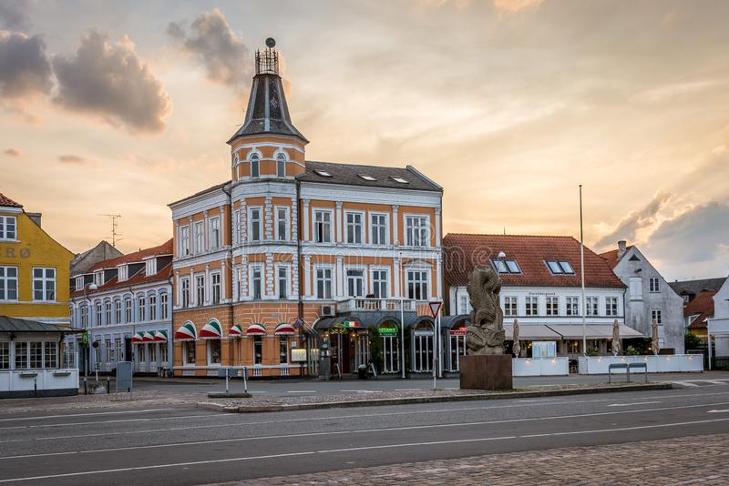 Old houses in the sunset over the harbour square in Svendborg, Denmark. July 10, 2019 royalty free stock images