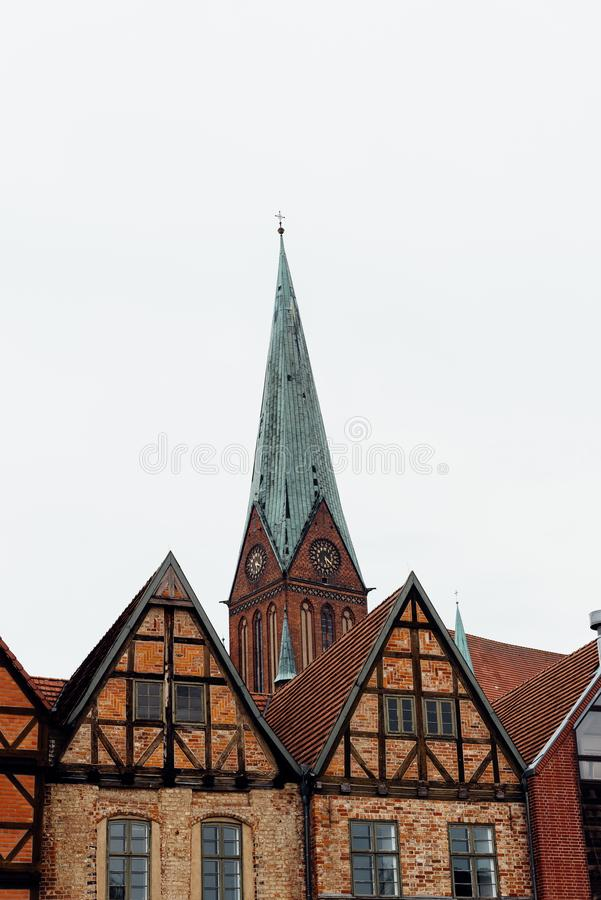 Old houses and tower of the of the Cathedral of Schwerin in Germany. Rainy day of summer royalty free stock photos