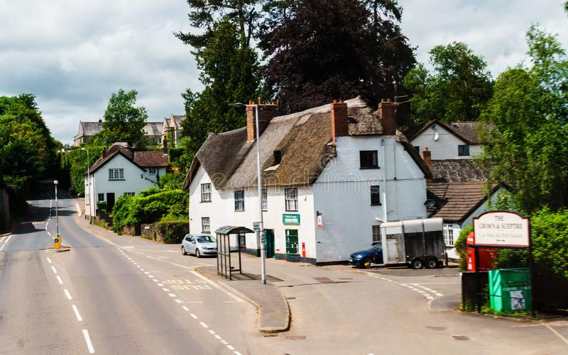 Old houses under thatched roof in the city of Crediton, Devon, United Kingdom June 2, 2018.  royalty free stock photography