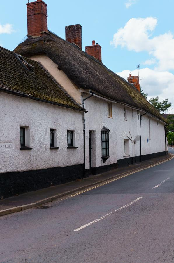 Old houses under thatched roof in the city of Crediton, Devon, United Kingdom June 2, 2018.  stock photos