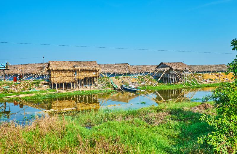 Old huts by the river, Yangon suburb, Myanmar royalty free stock photo